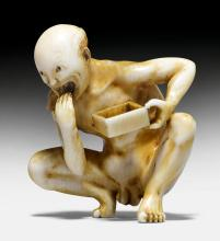 AN INVORY NETSUKE OF A NAKED MAN EATING IN A SQUATTING POSITION.