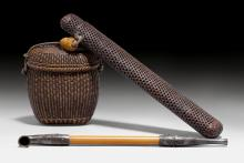 A WOOVEN BAMBOO TABAKO-IRE AND KISERUZUTSU WITH A SILVER MOUNTED PIPE.