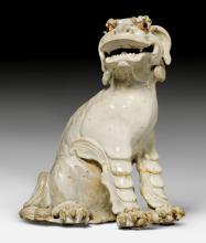 A LIVELY CERAMIC FIGURE OF A KOREAN LION-DOG (KOMAINU).
