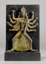 A BRONZE FIGURE OF TEN-ARMED DURGA IN A WRATHFUL POSE.