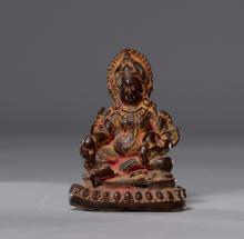A SMALL BRONZE FIGURE OF JAMBHALA WITH TRACES OF RED OFFERING POWDER. Nepal, 15th c. Height 8 cm.