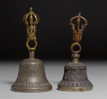 TWO BRONZE AND BELL METAL GHANTAS WITH VAJRA TERMINALS AND RELIEF DECORATION ON THE BELLS.