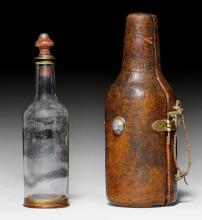 A WOOD AND LEATHER CASE WITH GLASS BOTTLE.