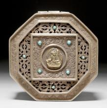 AN OCTAGONAL SILVER BOX WITH OPENWORK LID AND ENGRAVED EMBLEMS OF TIBETAN BUDDHISM, INLAID WITH TURQUOISES.
