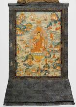 A THANGKA DEPICTING THE BUDDHA WITH A PARASOL ON A LOTUS WITH MONKS AND TWO BODHISATTVAS, MOUNTED ON SILK BROCADE WITH A COVER.