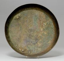 A ROUND BRONZE BOWL WITH CARP AND LOTUSES IN RELIEF.