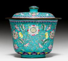 A CANTON ENAMEL CUP AND COVER WITH LOTUSES, BLOSSOMS AND LEAFY VINES ON A TURQUOISE GROUND.