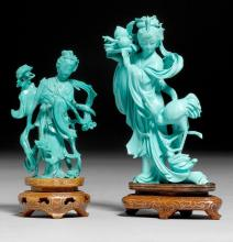 TWO FIGURES OF STANDING LADIES IN A TURQUOISE-LIKE MATERIAL WITH WOODEN BASES.