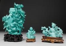 THREE SCULPTURES OF TURQUOISE-COLOURED MATERIAL ON WOODEN BASES.