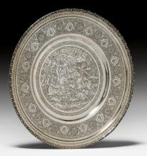 A SILVER PLATE ENGRAVED AND PUNCHED WITH A HUNTING SCENE WITHIN A BORDER OF FLORAL CARTOUCHES AND LEAFY VINES.