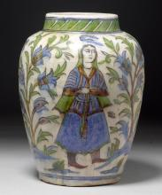 A POLYCHROME BALUSTER VASE PAINTED WITH FIGURES AMONG FLOWERING PLANTS.
