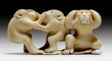 A SMALL IVORY OKIMONO OF THREE MONKEYS.
