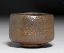 A SMALL TEA BOWL BY SASAKI SHÔRAKU (b. 1944) WITH RAKU SEAL, IN THE STYLE OF RAKU CHÔJIRÔ.