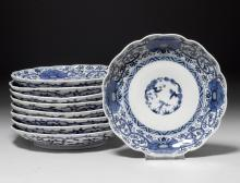 """NINE BLUE-AND-WHITE PLATES SHOWING """"THE THREE FRIENDS OF WINTER"""" WITHIN A FLORAL BORDER."""
