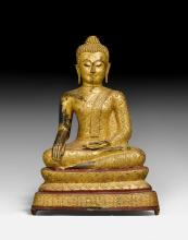A RED AND GOLD LACQUERED BRONZE FIGURE OF THE BUDDHA MARAVIJAYA.