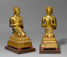 A PAIR OF WORSHIPPERS, OF RED-LACQUERED BRONZE AND GILT BLACK LACQUER.
