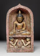 A WOOD AND POLYCHROME LACQUER FIGURE OF THE BUDDHA SEATED IN A NICHE WITH WORSHIPPERS. Burma, 19th c. Height 38 cm.
