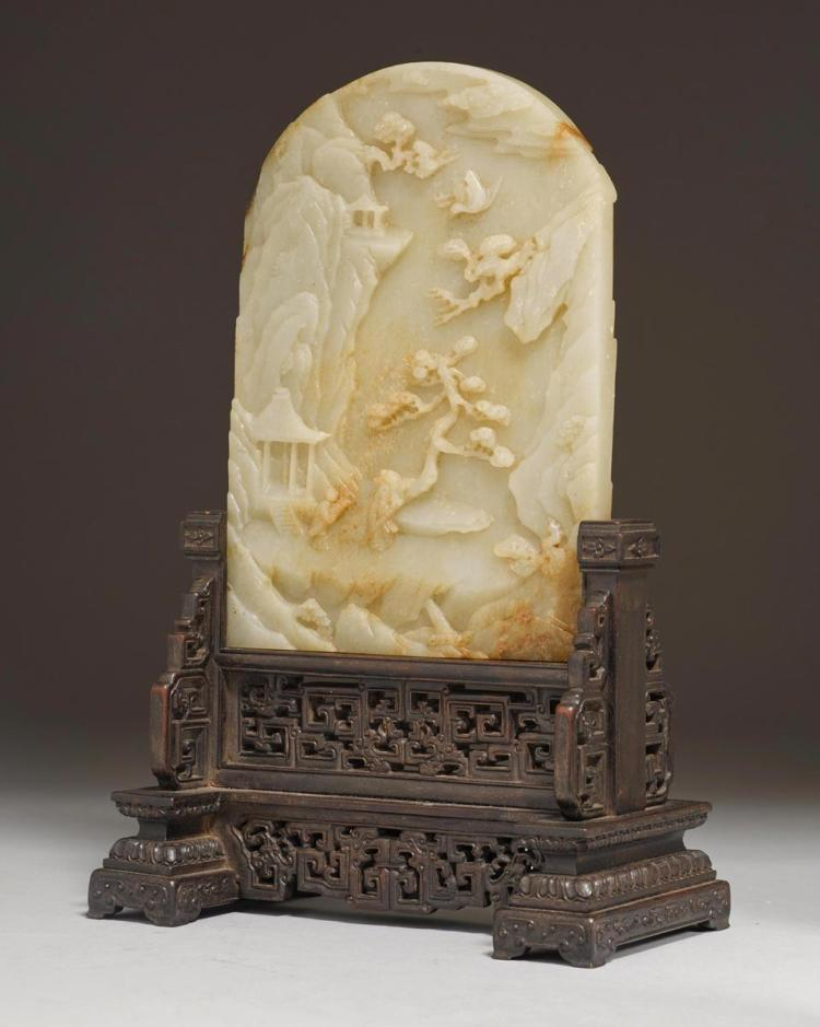 A carved jade table screen