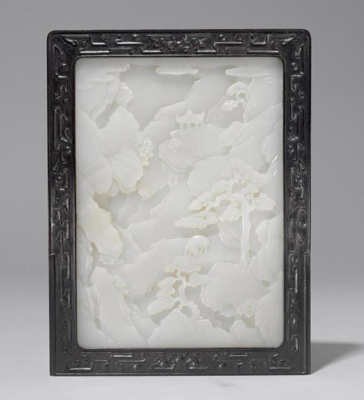 A finely carved white jade plaque