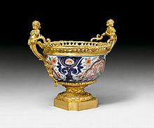 LARGE BOWL WITH BRONZE ORNAMENT, in the Louis XV