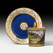DISPLAY CUP AND SAUCER WITH TOPOGRAPHICAL DECORATION,
