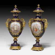 PAIR OF PORCELAIN VASES WITH A BRONZE MOUNT