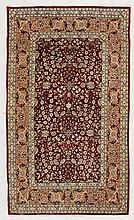 HEREKE SILK. Red central field, finely patterned