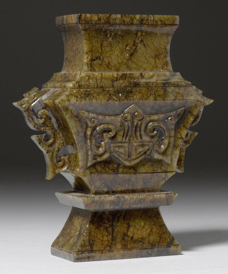 A rectangular jade vase carved with bats and openwork chilon