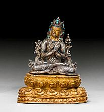 A SILVER FIGURE OF VAJRADHARA ON A GILT COPPER