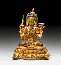 A GILT COPPER FIGURE OF MANJUSHRI WITH SILVER AND