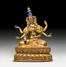 A GILT COPPER PARTLY REPOUSSE FIGURE OF