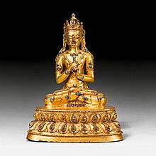 A FINE GILT COPPER FIGURE OF VAIROCANA WITH