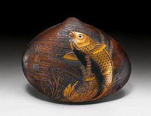 A SHELL SHAPED WOODEN BOX DECORATED WITH A CARP IN