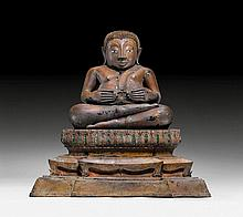 A BRONZE FIGURE OF THE SEATED PHRA SANGAJAYA.
