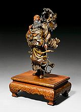 A VERY LIVELY BRONZE FIGURE OF A SAGE STRUGGLING