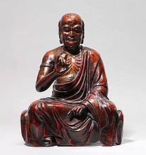 SEATED RAKAN.Japan, 19th c. H 58 cm.Wood, red and