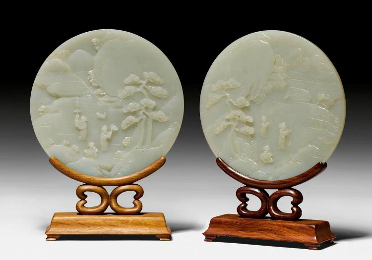 A pair of exquisitely in relief carved pale celadon and crea