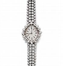 DIAMOND LADY'S WRISTWATCH, ca. 1960.White gold