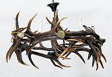 ANTLER CHANDELIER,in the rustic style.Round,