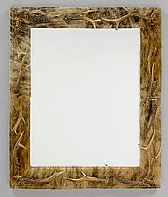 MIRROR DECORATED WITH COW HIDE AND ANTLERS, in the