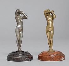 1 PAAR STATUETTEN, Bronze, die eine versilbert.