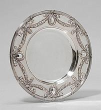PLATE,20th century.Round. The edge with chiselled