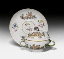 ECUELLE 'DRESSED-UP CUPIDS' AND SAUCER,