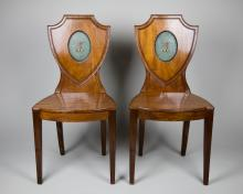 Pair 19th C. English Hall Chairs with Unusual Painted Family Crest