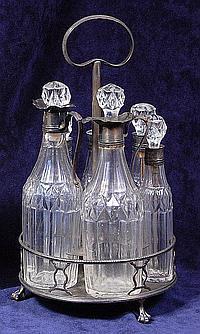 An early George III silver six bottle cruet stand