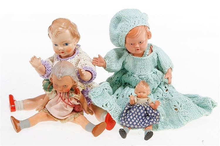 4 versch. Puppen
