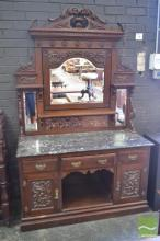 Late Victorian Carved Walnut Washstand, with adjustable mirror & tiled back, black marble top, three drawers & two doors flanking an...