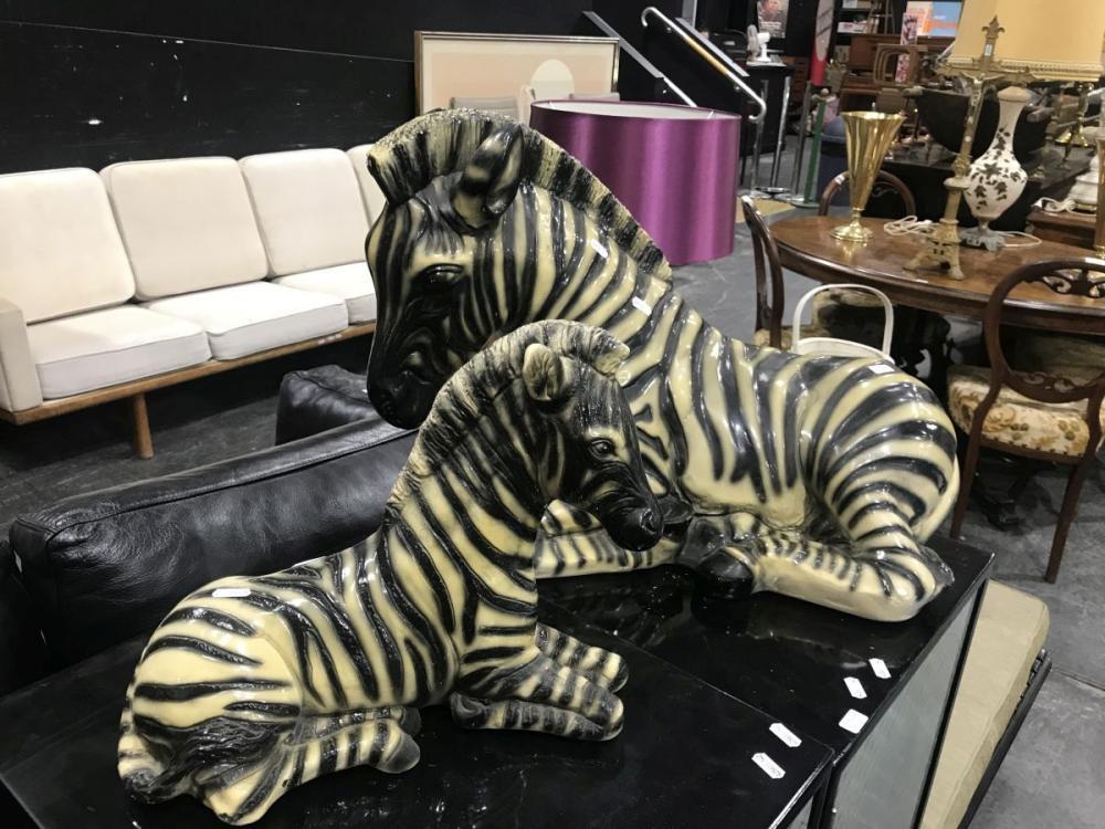 Two Seated Zebra Figures