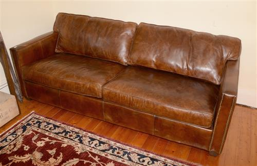 A three seater distressed brown leather sofa with chrome stu for Brown leather couch with studs