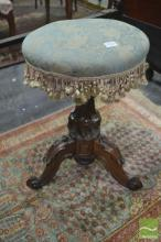 Victorian Carved Walnut Piano Stool, the upholstered revolving top with fringe